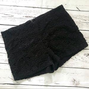 Monteau black lace crocheted hot pants shorts